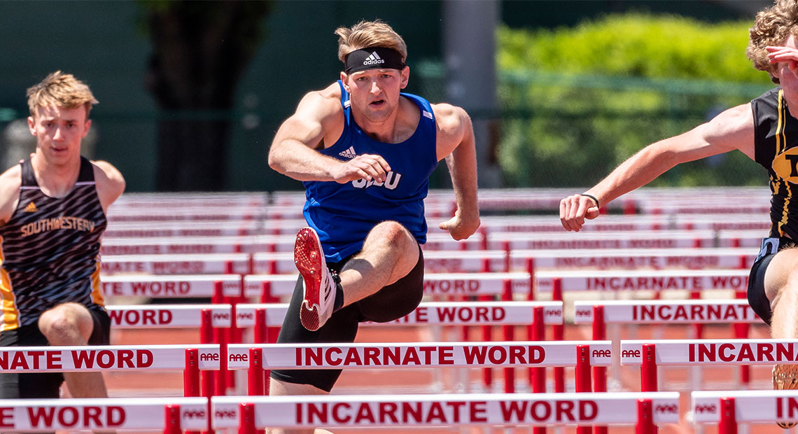 Clayton Townsend runs the 110m Hurdles.