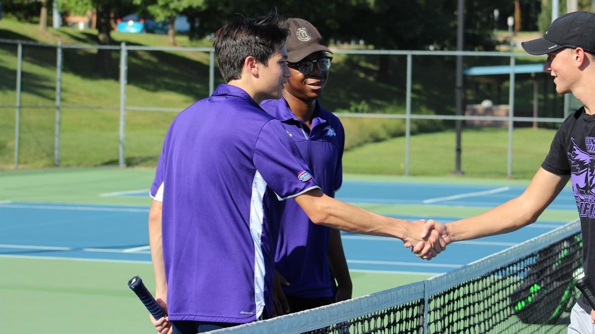 Court 3 doubles partners James Bamberger and Naphtali Eke shake hands with their opponents after a match. Photo by Linda Muel